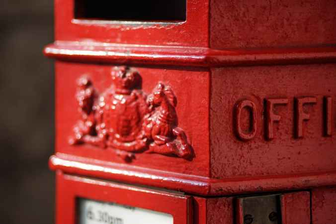 red and white metal mail box