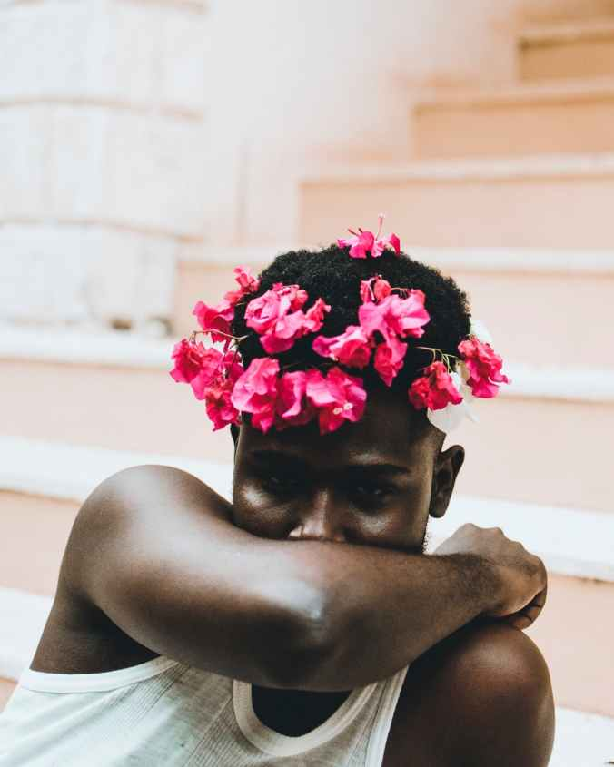 man with pink floral headdress