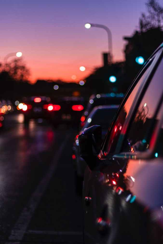 photo of vehicle on asphalt road