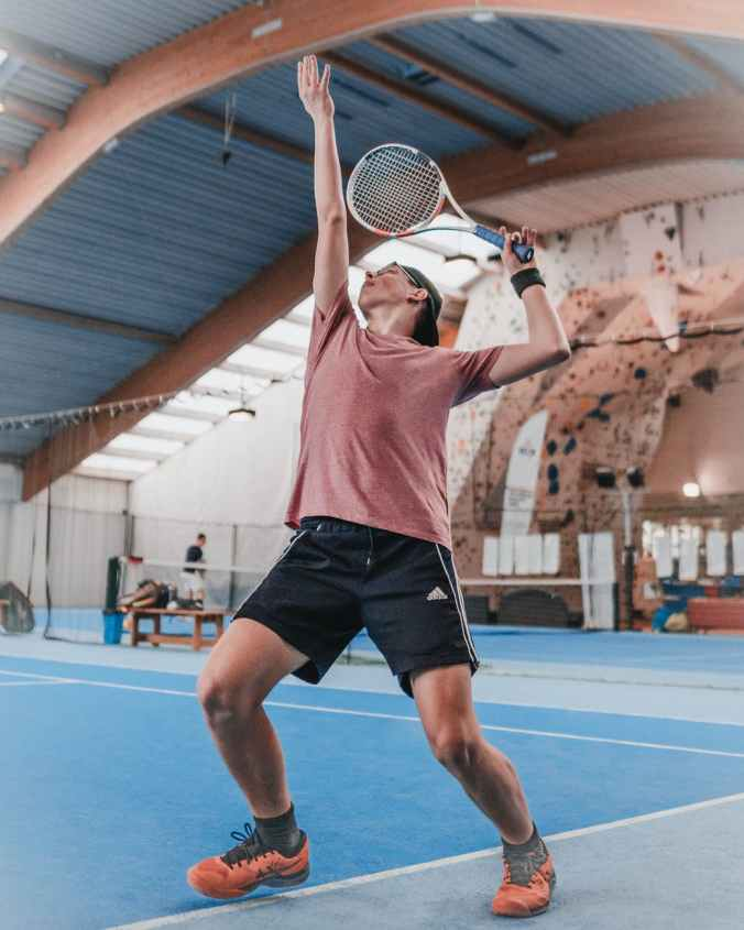 photo of man playing tennis