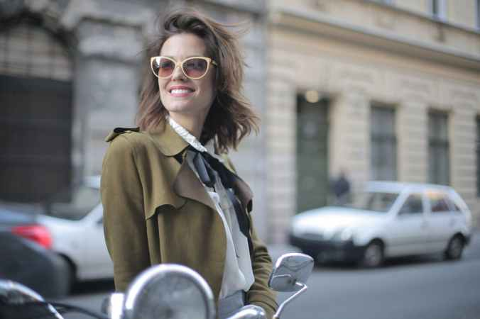 magnificent stylish confident woman on street in city